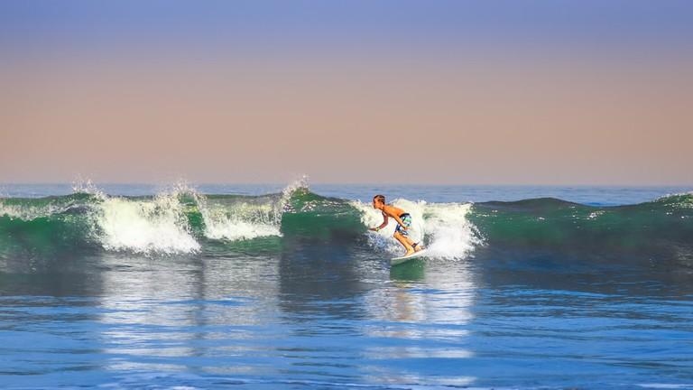 Boy Surfing in Kuta, Bali