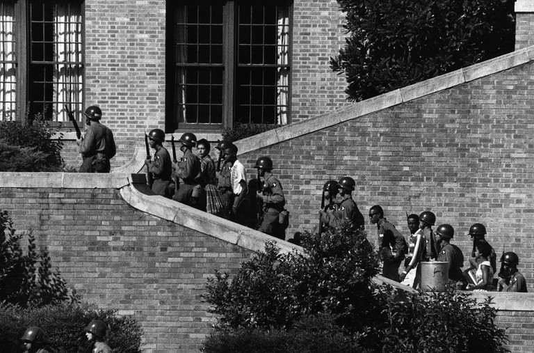 Operation Arkansas: A Different Kind of Deployment Photo by Courtesy of the National Archives September 20, 2007 Soldiers from the 101st Airborne Division escort the Little Rock Nine students into the all-white Central High School in Little Rock, Ark