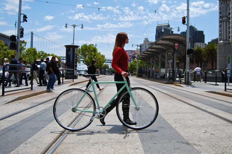 Girl Walking Bike On Embarcadero | © Mission Bicycle Company/Flickr