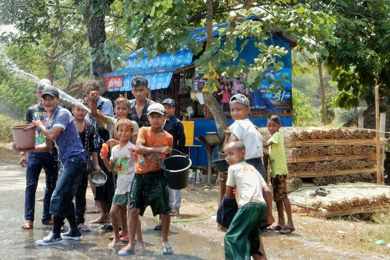 Children throwing water at passers by, Ayeyarwady Delta © Kirsten Henton
