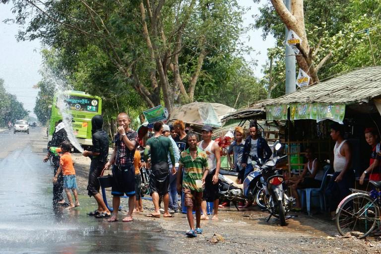 Locals armed with water, Ayeyarwady Delta © Kirsten Henton