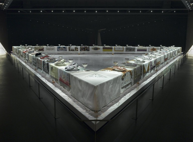 Judy Chicago, The Dinner Party, 1463 x 1463 cm, Ceramic, porcelain, textile, triangular table. Brooklyn Museum, Gift of The Elizabeth A. Sackler Foundation, 1974-79 | © Judy Chicago (Photo: Brooklyn Museum)