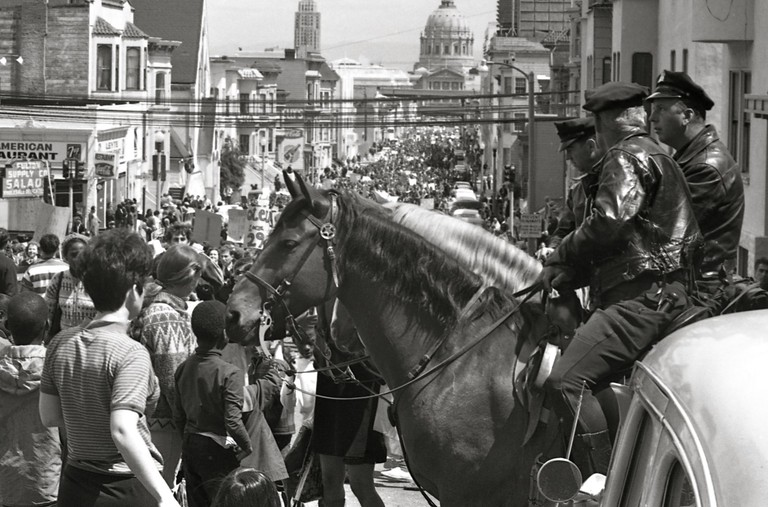 Mounted policemen watch a Vietnam War protest march in San Francisco, April 1967