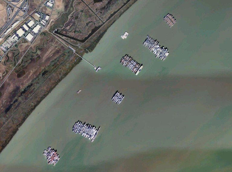 Ships at Suisun Bay, California. Note USS Iowa (BB-61) on the bottom end of the second row from the bottom @ USGS/Wikipedia