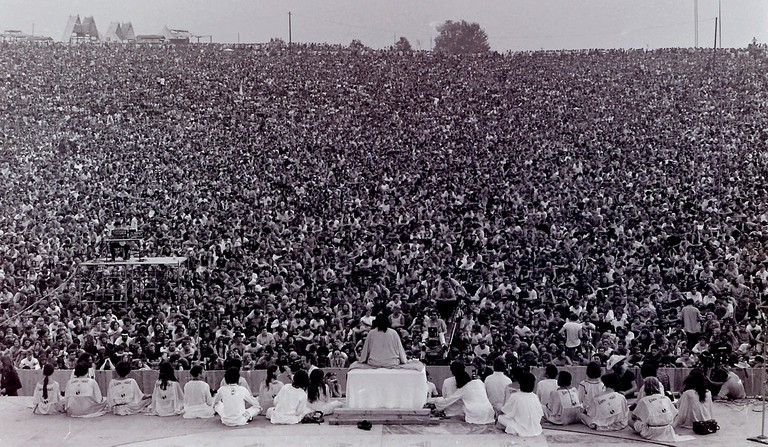Opening ceremony at Woodstock. Swami Satchidananda giving the opening speech - - Mark Goff@Wikipedia
