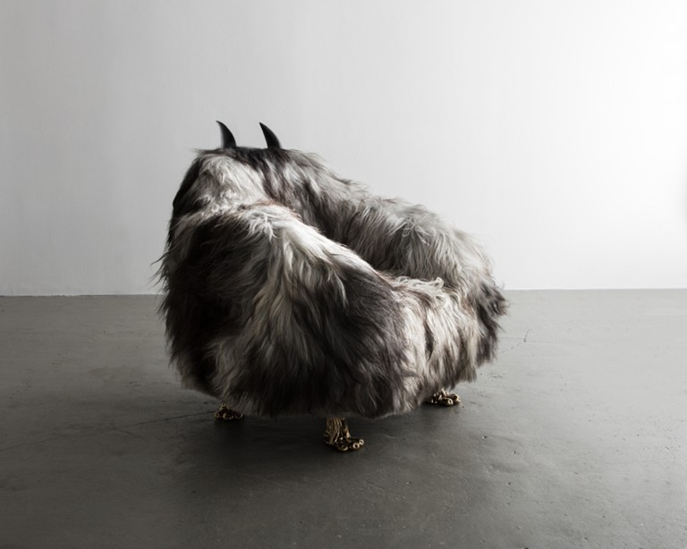 The Haas Brothers Unique Throb Dylan club chair in gray Icelandic sheepskin with cast bronze coyote feet and carved ebony horns