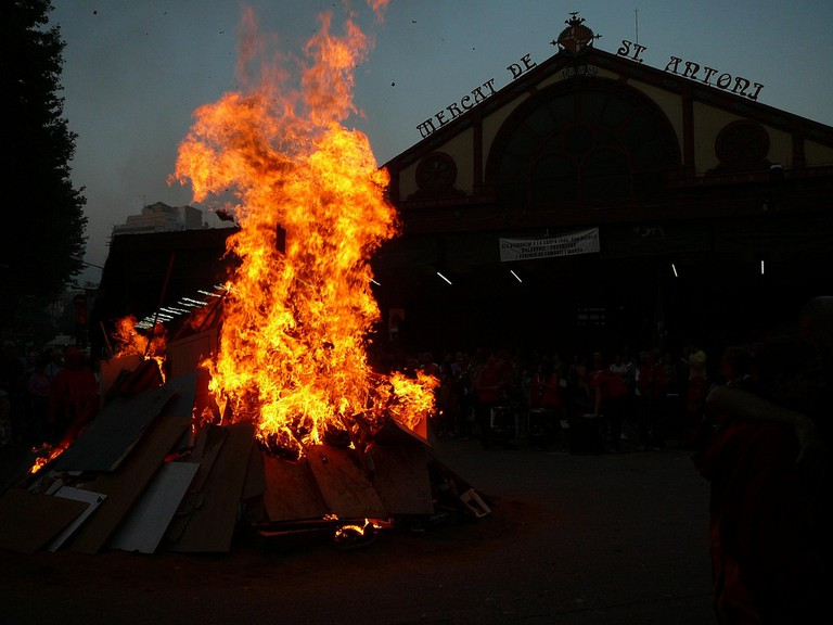 The lighting of a bonfire by Sant Antoni market in Barcelona