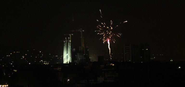 Fireworks are set off besides Barcelona's iconic Sagrada Família basilica