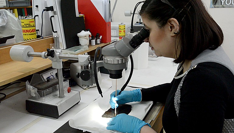 Luisa Duarte conserving a writing tablet | Courtesy of MOLA