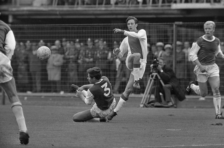 Johan Cruyff playing for his former team, Ajax