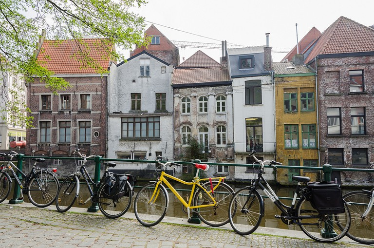 Some bikes parked next to Ghent's charming canals, another thing it has in common with Amsterdam | © Sandra Vallaure