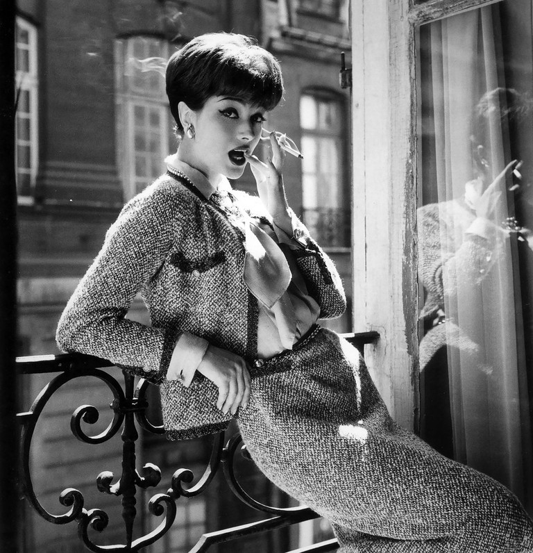 Marie-Hélène Arnaud (in a Chiné tweed Chanel suit) photographed by Santé Forlano for 'Vogue,' 1958