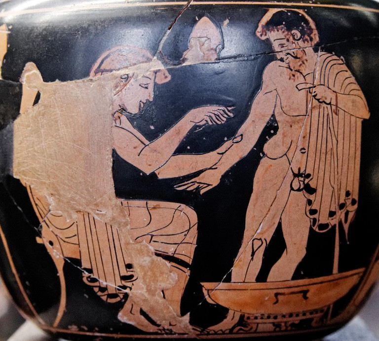 An ancient Greek receives attention from a doctor.
