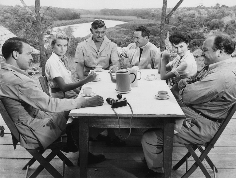 The cast of Mogambo L. to R. : Donald Sinden, Grace Kelly, Clark Gable, Denis O'Dea, Ava Gardner & Eric Pohlmann ©unknown (MGM)/WikiCommons