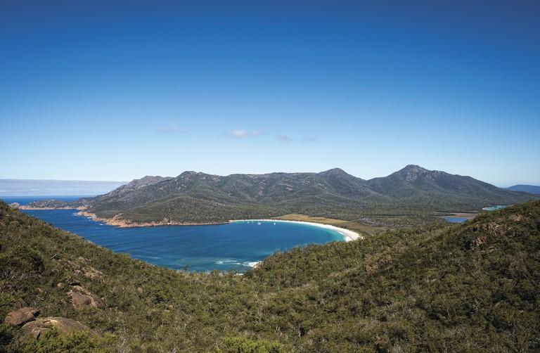 Wineglass Bay from Mt Amos on the Wineglass Bay Track, Freycinet National Park, TAS | Courtesy of Tourism Tasmania © Rob Burnett