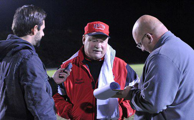 Easton football coach Steve Shiffert talks to the media | © Michael LoRe