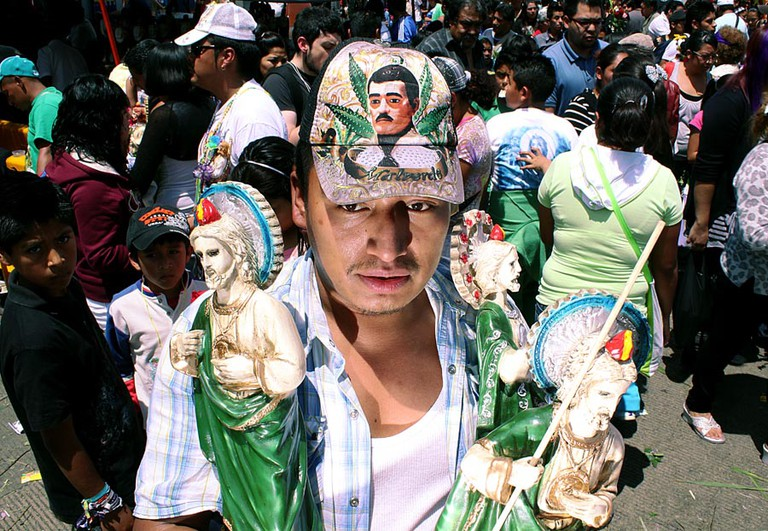 Malverde, icon of narcoculture, baseball cap | © Angel Morales Rizo/Flickr