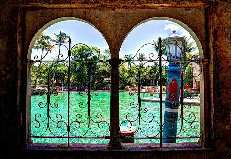 A window looks out onto the Venetian Pool