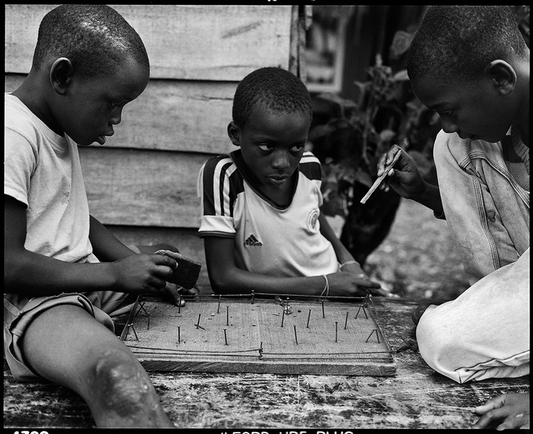 Buenaventura, Colombia. Children in Puente Nayero play an improvised game of table football. The success of the Puente Nayero Humanitarian Space has encouraged residents on the neighboring street of Punta Icaco to begin organizing to create their own humanitarian space.