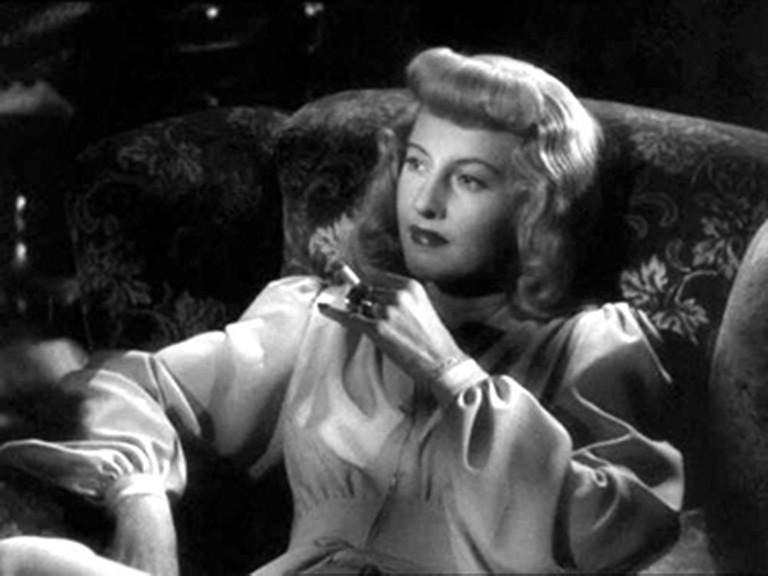 Barbara Stanwyck smolders as Phyllis Dietrichson