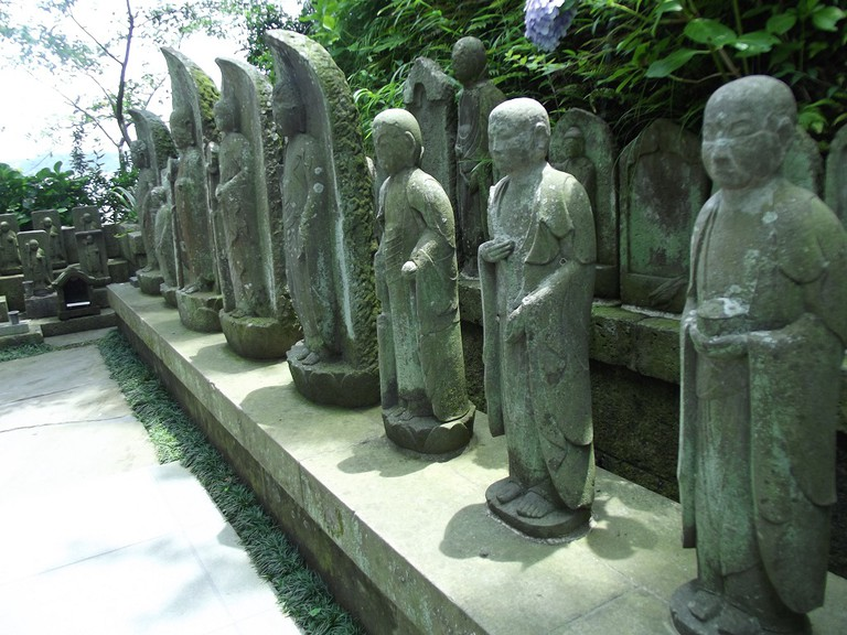 Various buddharupta in a temple garden