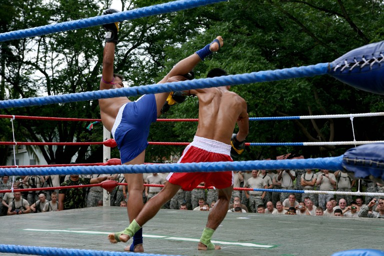 Muay Thai fight held in an outdoor arena