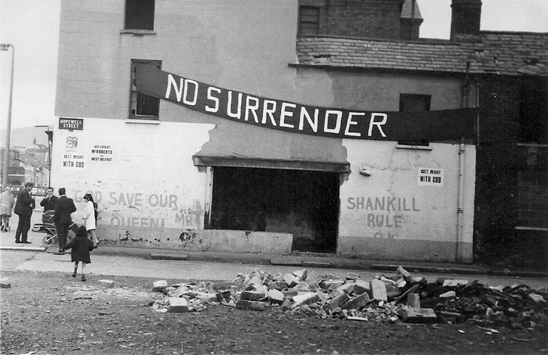 Loyalist banner and graffiti on a building in the Shankill area of Belfast, 1970