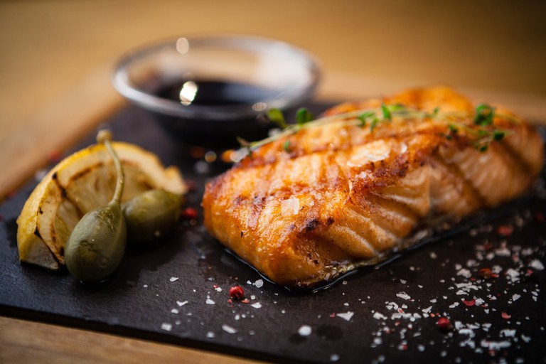 Grilled Scottish salmon with soy sauce and herbs