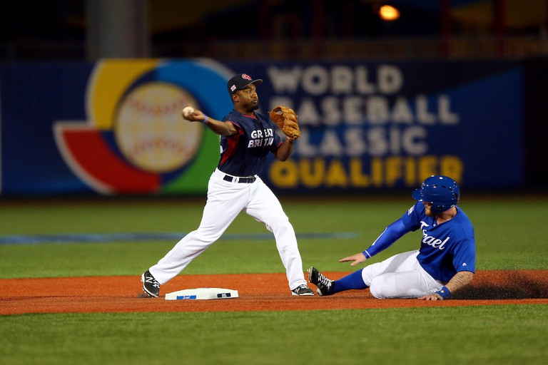 Albert Cartwright turns a double against Team Israel in Game 2 of the 2016 WBC Qualifier | © Alex Trautwig/MLB Photos via Getty Images