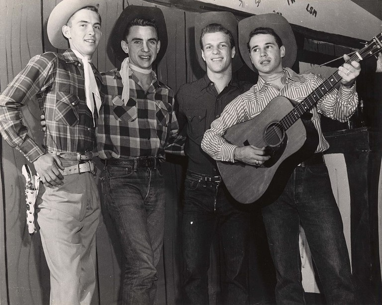 Blue jeans, Stetsons and press stud plaid Western shirts, c.1950 | Public Domain/Wikicommons