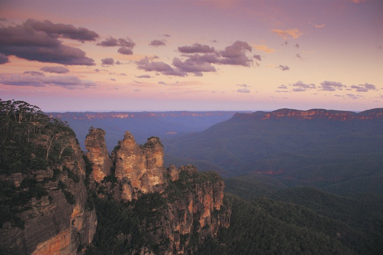 Sunset on the Three Sisters, Echo Point, Katoomba. View features Mount Solitary in middle distance