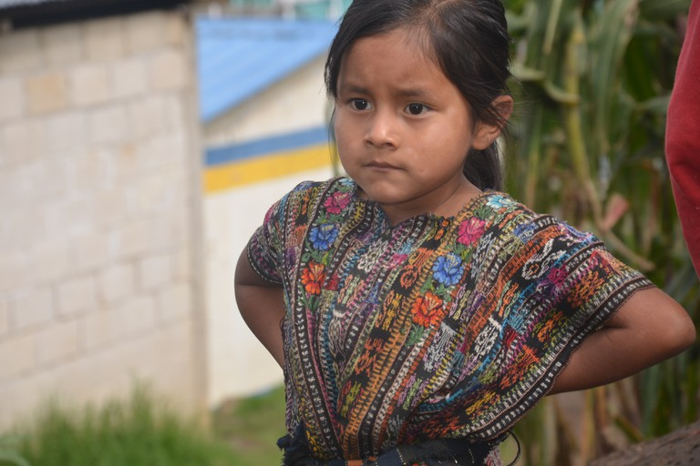 Young Guatemalan child wearing a huipil