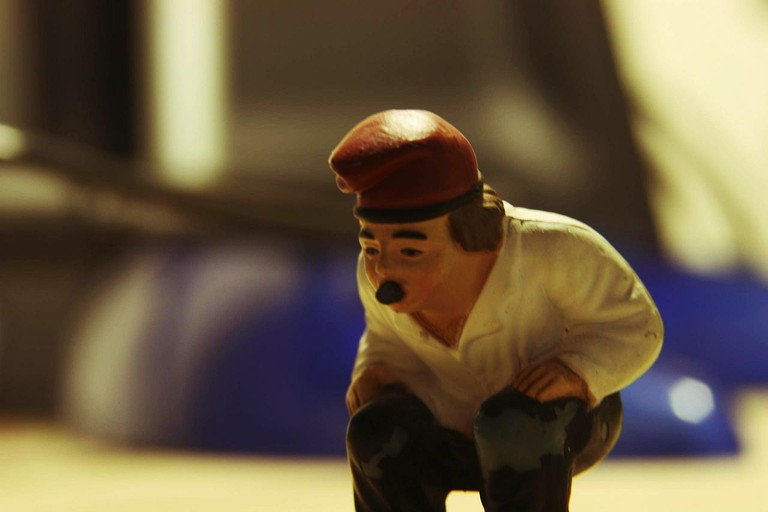 A caganer getting on with his business