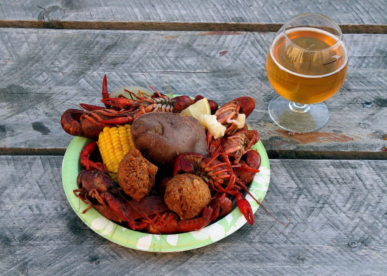Crawfish Boil for dinner as part of the Mardi Gras celebration at Burial Brewery, accompanied by a Blade & Sheath beer