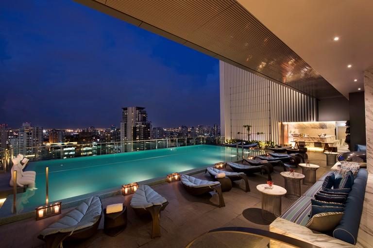 Hilton Sukhumvit Bangkok pool at dusk