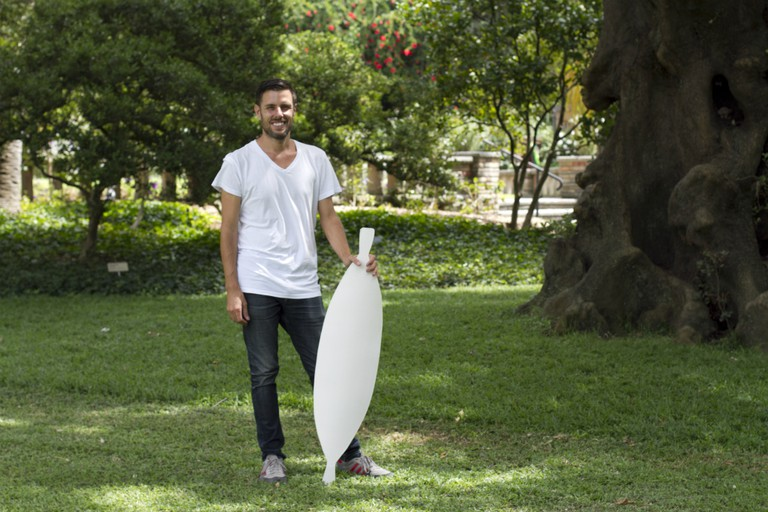 Jonathan Jones with prototype ceramic shield on site at the Royal Botanic Garden, Sydney.