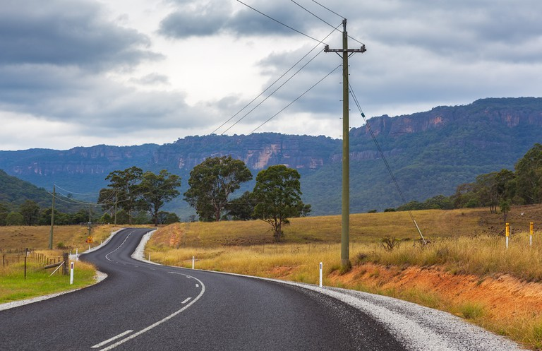 Scenic winding rural road in Wollemi National Park, New South Wales, Australia