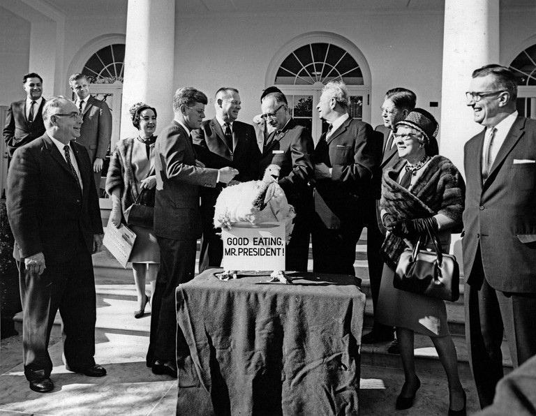 President John F. Kennedy spares the turkey presented to him, 1963, only three days before his assassination. | Public Domain/Wikicommons