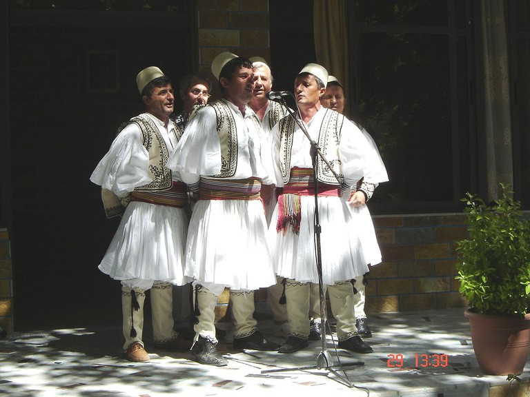 Albanian polyphonic group from Skrapar wearing qeleshe and fustanella