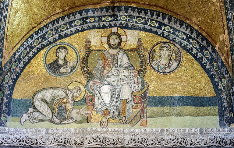 Imperial Gate mosaics in the former basilica Hagia Sophia of Constantinople (Istanbul, Turkey) The emperor Leo VI the Wise is bowing down before Christ Pantocrator. In medallions: on the left of Christ, the Archangel Gabriel; on his right, Mary.