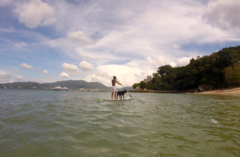 Paddleboarding off Paradise Beach