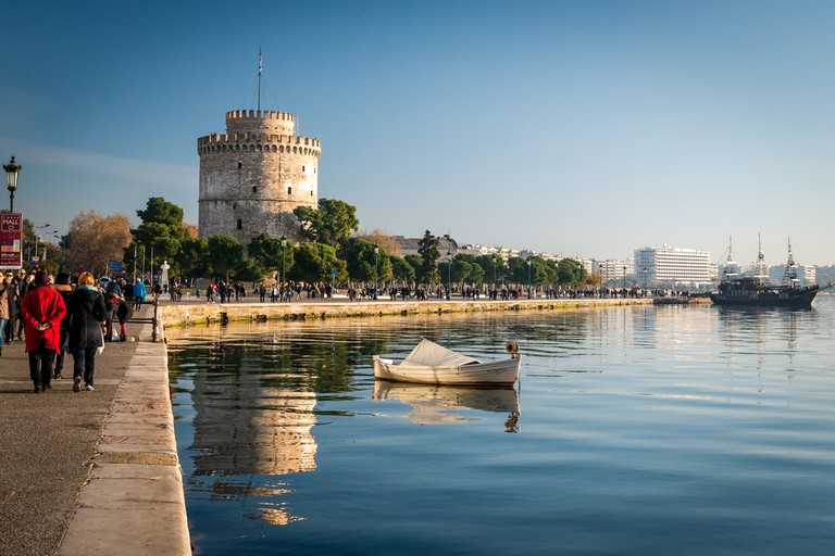 Thessaloniki next to the white tower, which once guarded the eastern end of the city's sea walls