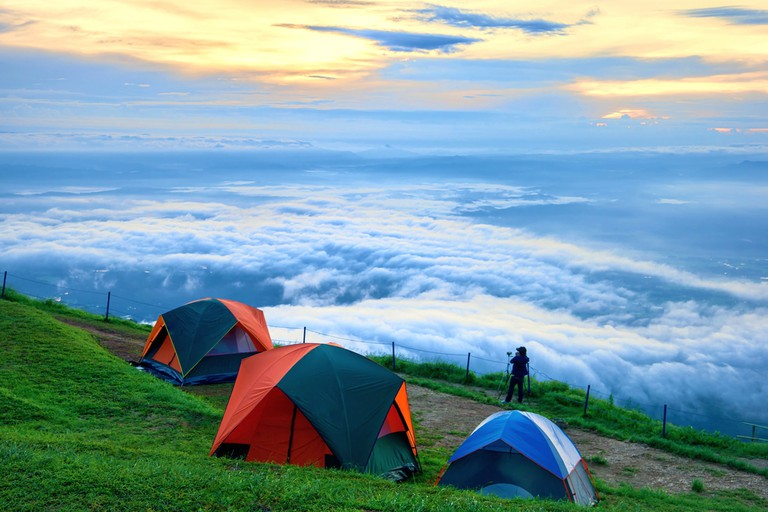 Camping at the climbing Phu Thap boek from the country of Thailand. Camping on the holiday. Camping on the grass. Camping on the mountain fog beautiful sea view