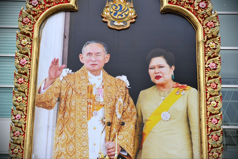 Portraits of Thai King Bhumibol are seen commonly on buildings across Thailand