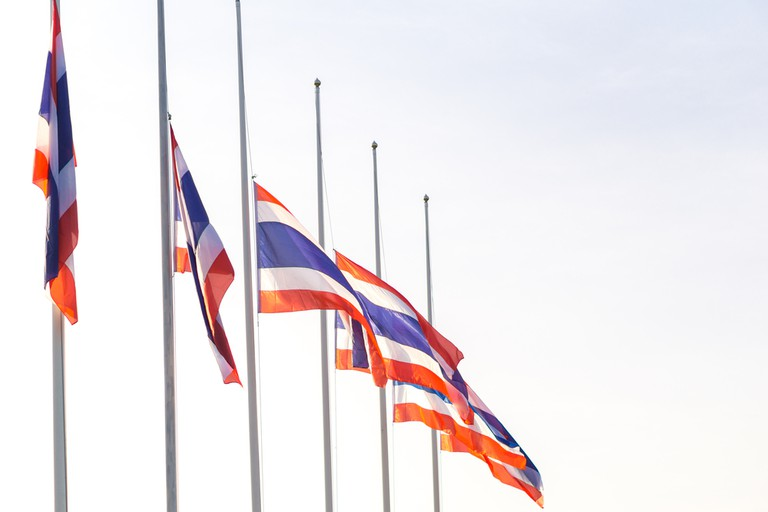 Thai flag was lowered to half-mast for paying respect for the king of Thailand