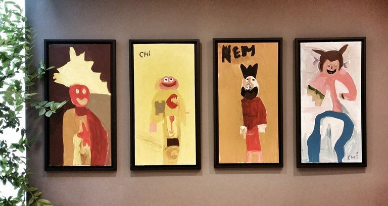 Nem's paintings on the wall