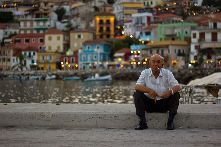 Man sitting by the waterfront