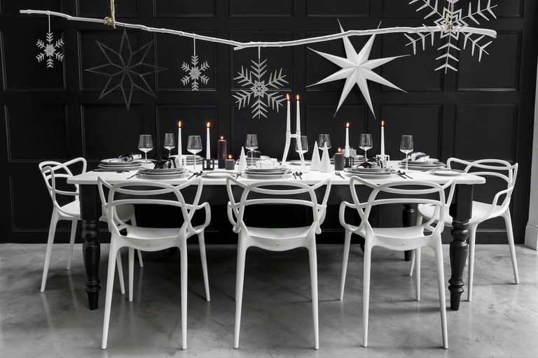 Scandi monochrome interiors have inspired this Christmas dining scheme from Amara