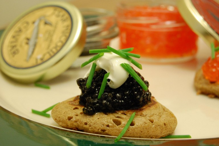 Caviar and homemade blini with crème fraiche │