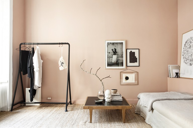 This Stockholm apartment by stylist Emma Wallmen mixes a warm pink with natural materials for a cosy feel